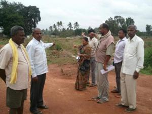 FB.Metropolitan Cooperative Housing Society has built a residential layout on their land and allotted plots to IAS
